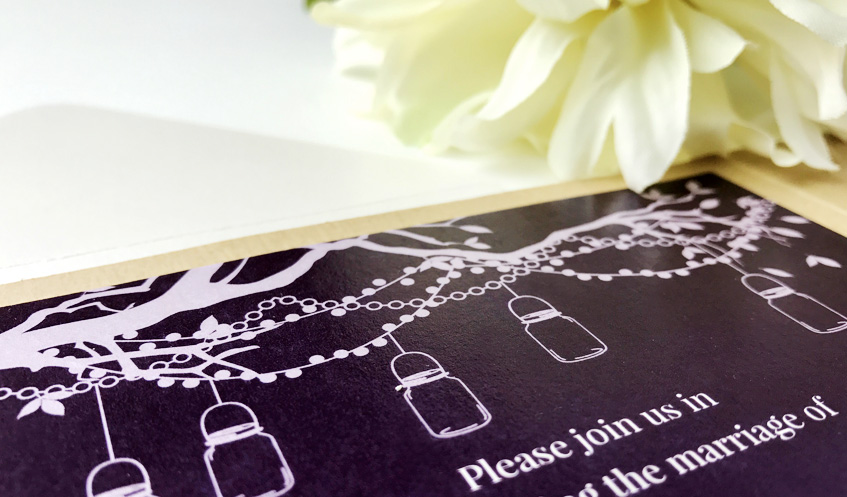 The string light and mason jar illustration featured on Erin & Jeremy's wedding invitation.