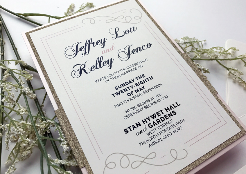 Gold glitter accents add a glam feel to this formal invitation.