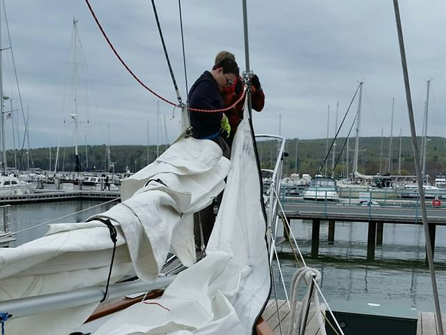 Sea Scouts bending on sails