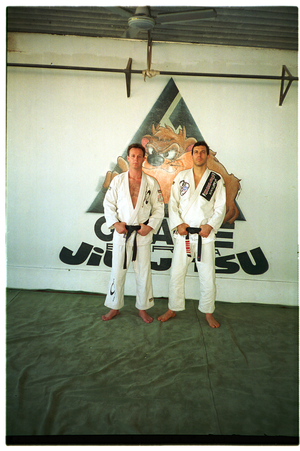 Pete and Carlinhos at the original Gracie Barra Academy, Rio de Janeiro Brasil 1996. (Check out the mats!)