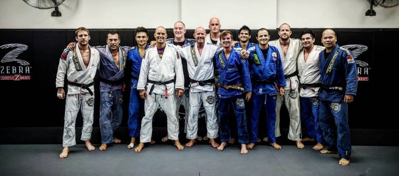 Group shot of brown and black belts after a training session at HQ.