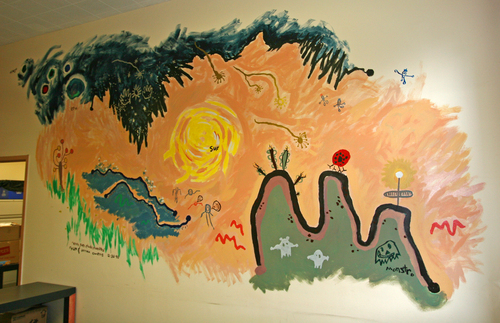 Prior to the IWS I started a small Writing Center in 1996, tucked away in another building--just 2 rooms, one with an enormous blank wall. One snowy day in 1998 I painted this mural: a depiction of the Universe incorporating drawings from my 5-year old son and his 5-year-old cousin. (I was later informed that I had vandalized the wall and it was painted over.)