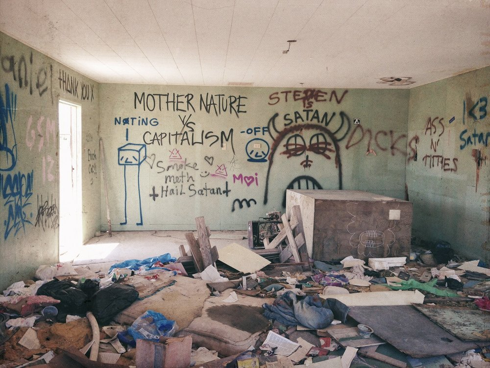 The graffiti covered walls of an abandoned Bombay Beach dwelling