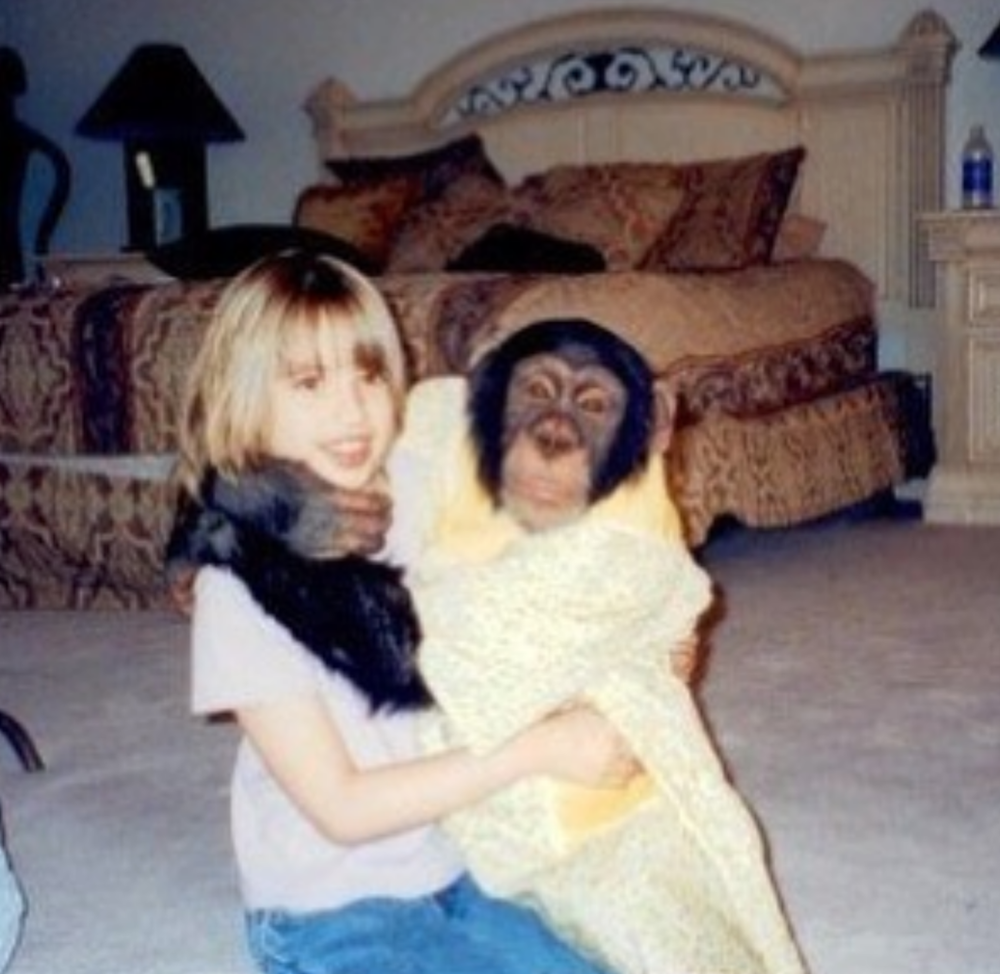 Baby Katie with monkey