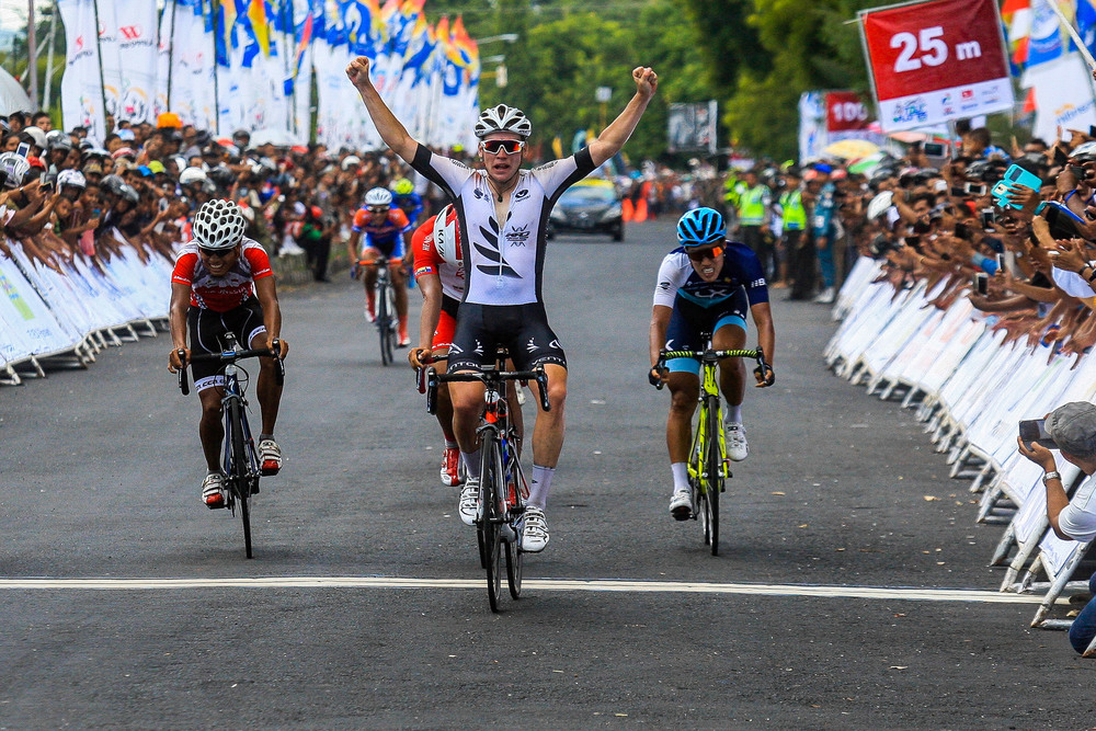 Jason Christie powers across the finish line to take stage 1. Photo courtesy of Mokhriz Aziz