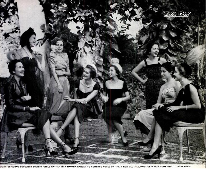 1950's photograph of Cuba's loveliest society girls gathered in a Havana garden to compare notes on their new clothes.