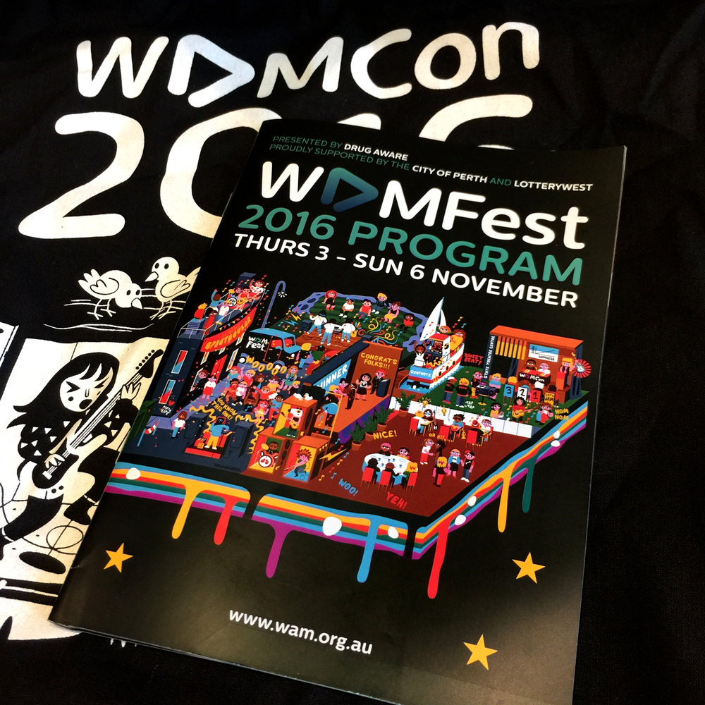 Canvas bag and event program given to WAMCon attendees.