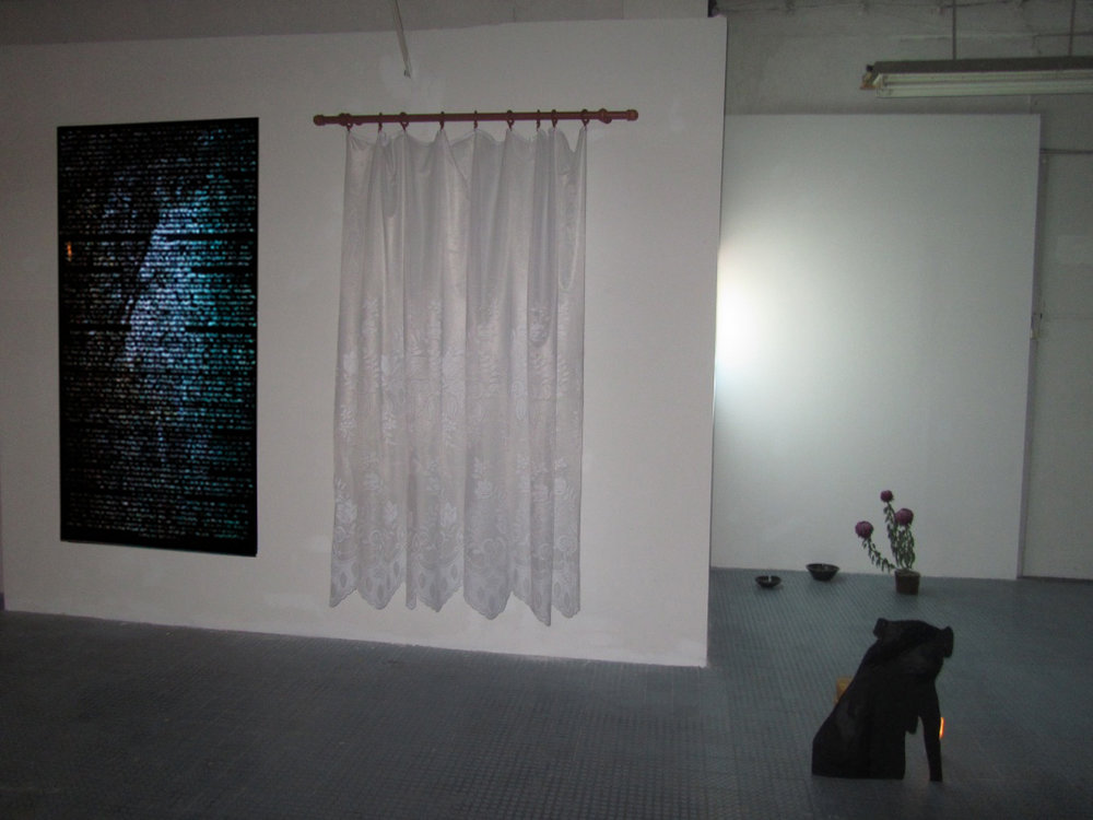 The Light and the Heavy , 2016, Installation view at D'Clinic Studios, Zalaegerszeg, Hungary  1.  The boar who became a deer  interactive mapping video on digital print.  2.  Resistance  lace curtain and curtain rod  3. (Front)  He had been given a name and it was clear that he knew something  wood, paper, paint, bricks, candle   4. (Back)  Untitled cermic bowls made at Gébárti Kézművesek Háza during the Saturday morning pottery workshop, Chrysanthemum 'Regal Mist Purple' bought at the Zalaegerszeg farmers market on the 30th of October 2016