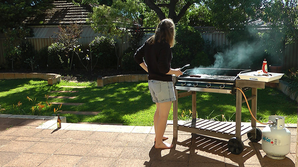 Selected stills from video 2014, documentation of occasional performance in own backyard in Australia, 15:56 minutes.