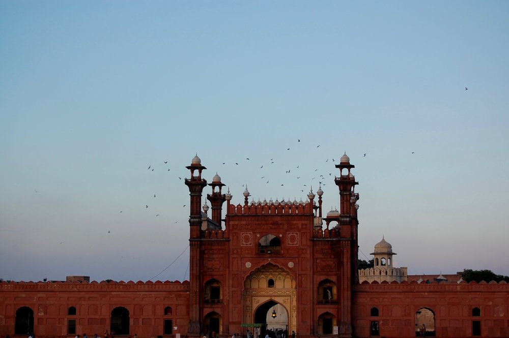 The third photograph was taken at Badshahi Mosque during Magrib.
