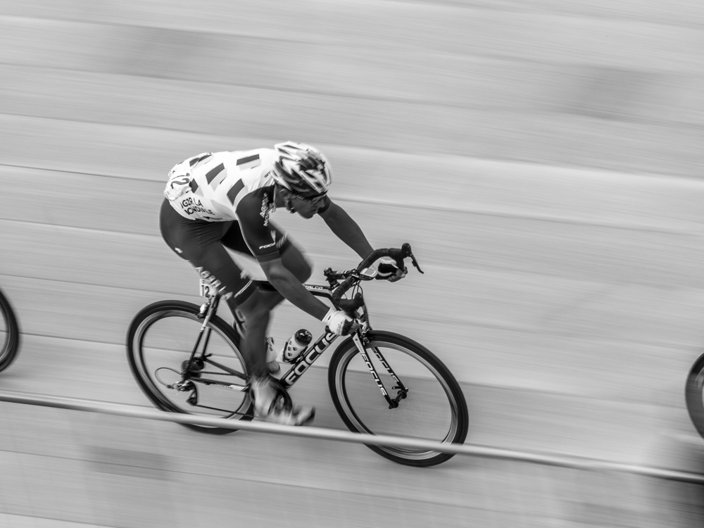 Panning shot of a pro cyclist using a shutter speed of 1/30 of a second