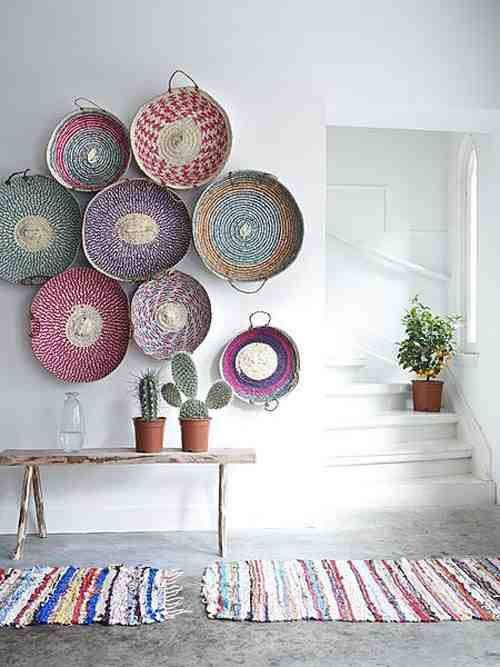 Rustic pastels - Woven baskets add interest against the smooth rendered wall.