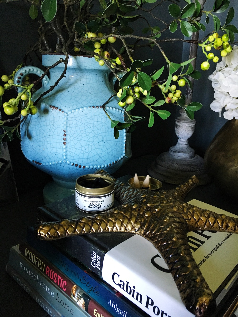 The gilded starfish - £15 ,  Finn vase medium - £45 ,  Evergreen berry branch - £11.95  ,   Muru scented Pyres - £30