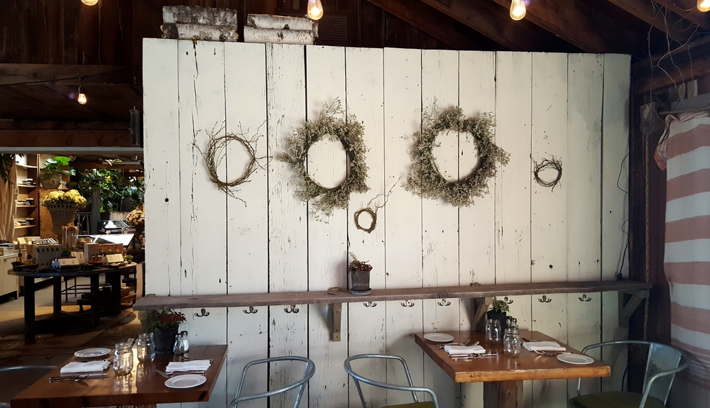 Charlene loves dried flowers as much as fresh. This distressed wall with dried floral wreaths is a wonderful backdrop for a rustic event.