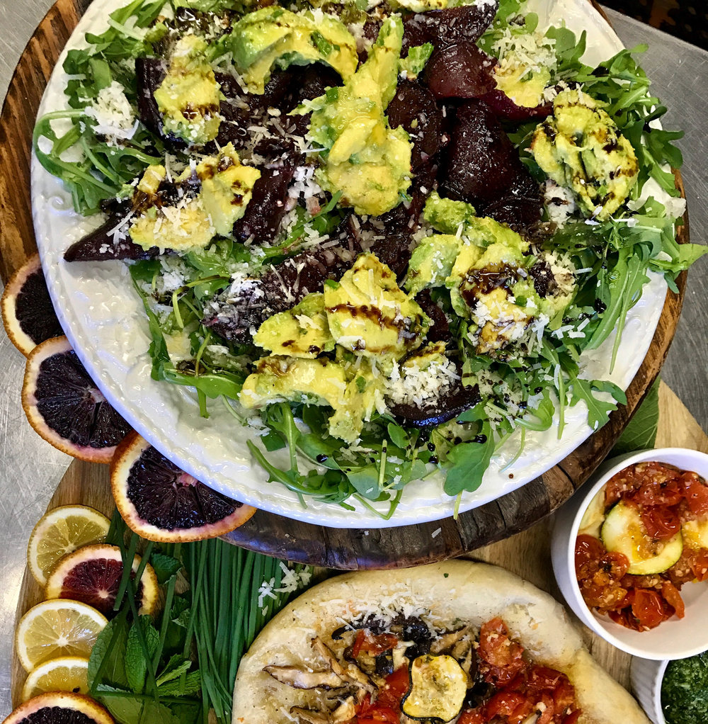 Mixed greens salad with avocado, roasted beets, reggiano cheese, arugula, chives, shallots, and balsamic drizzle. The perfect dish to go with our homemade pizza!