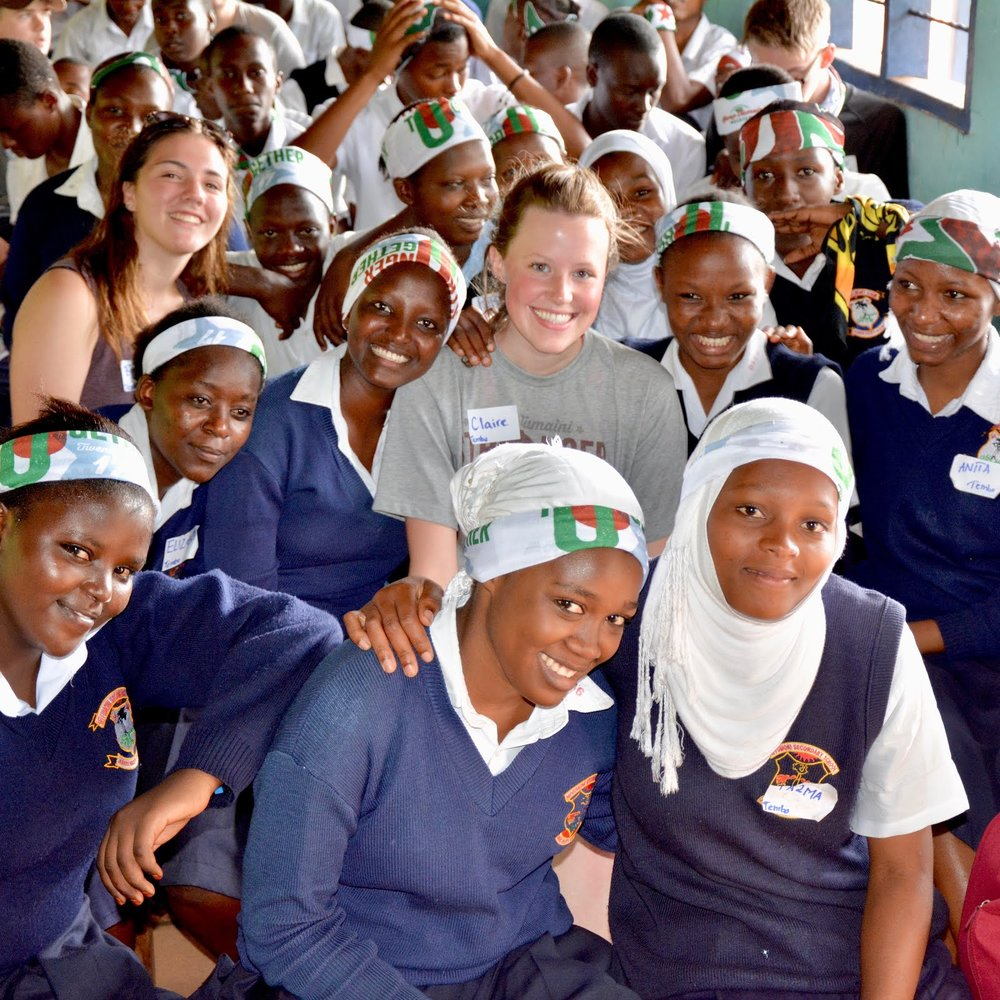 Claire with some Mivumoni Secondary School students.