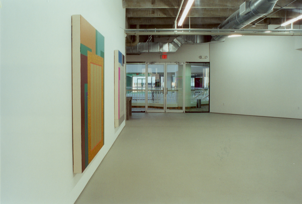 Located in a newly emerging design district, the gallery addressed the need for a space that would be a forum for contemporary art. The 3,800 sf gallery was divided in half. The left side is the main gallery and the right side is divided into two project rooms, an office and storage area. The lighting, exposed concrete ceiling, frosted storefront windows, galvanized steel ductwork, and poured concrete reception desk create a clean backdrop for art. The daylight-like fluorescent lighting in the main gallery offers an alternative approach to the atmospheric incandescent lighting found in most art galleries.
