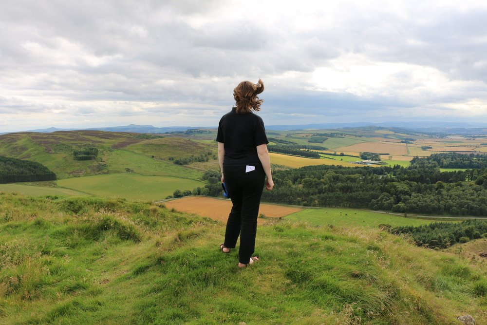 Sara taking in the view at the top of Dunsinane Hill, Perthshire, where Macbeth was defeated in battle.