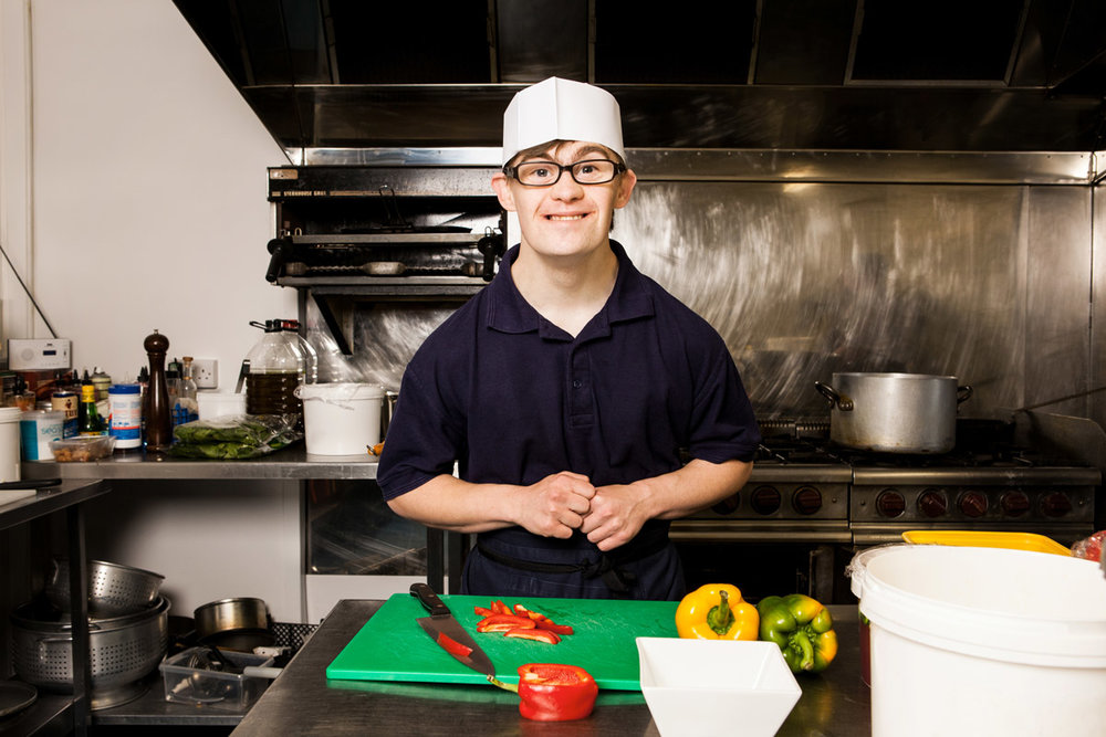 Young person working in the kitchen at Foxes Hotel