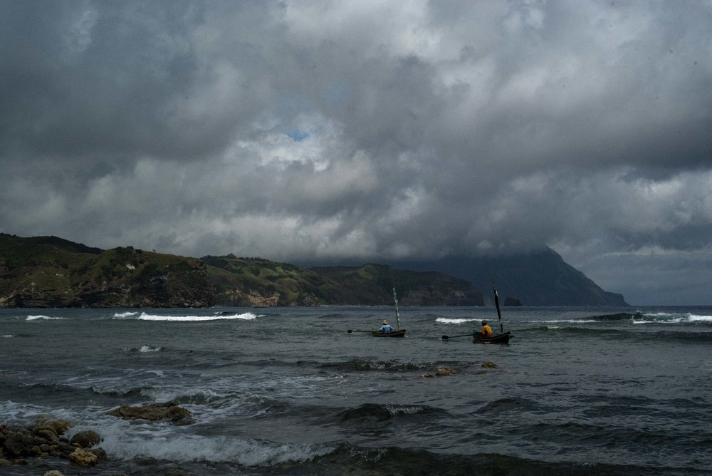 By 5AM, fishermen have paddled out into the Philippine Sea.