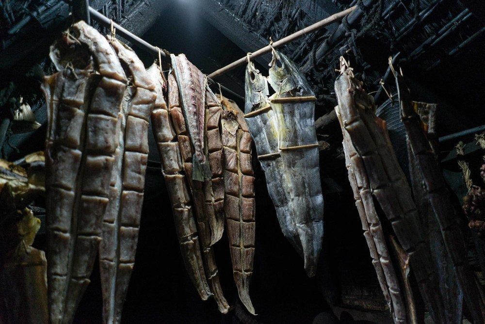 Smoked dorados are hung inside the fishermen's homes. Mahataos practice smoking as a curing method to have a supply of fish throughout the year.