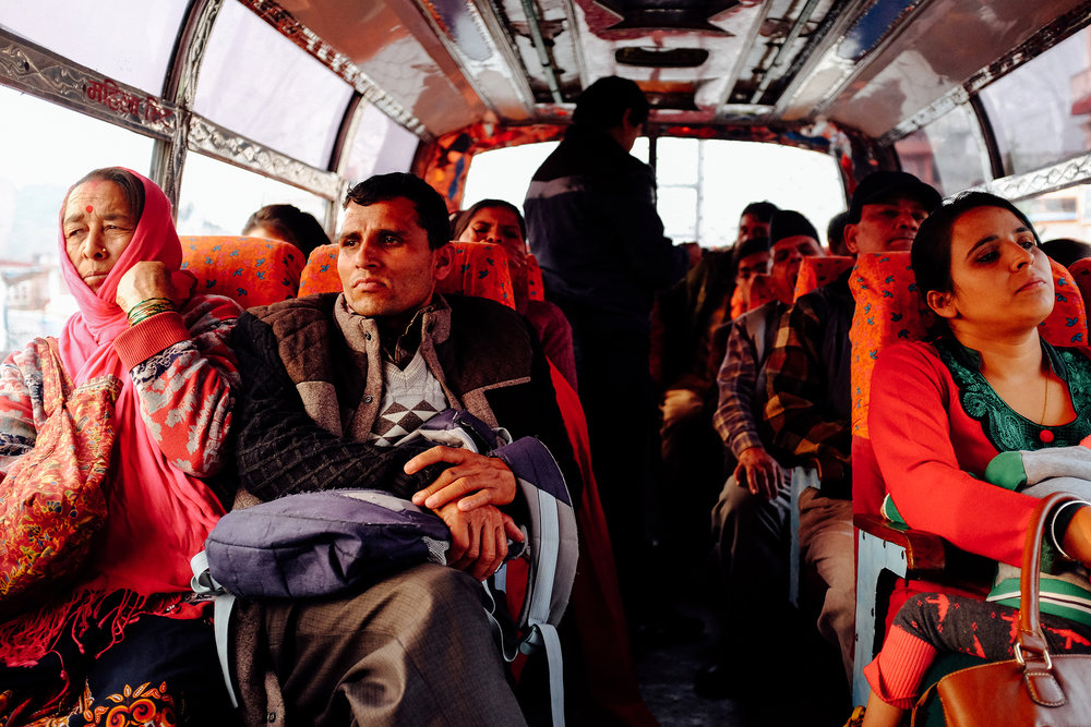 POKHARA, NEPAL — Commuters aboard a public bus in Pokhara after a day's work.