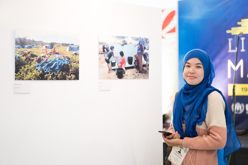 Saima Pagalad is among those who were displaced by the Marawi conflict. Some of the photos she took to document the forced displacement were featured in the exhibit. (Photo ©UNHCR/Martin San Diego)