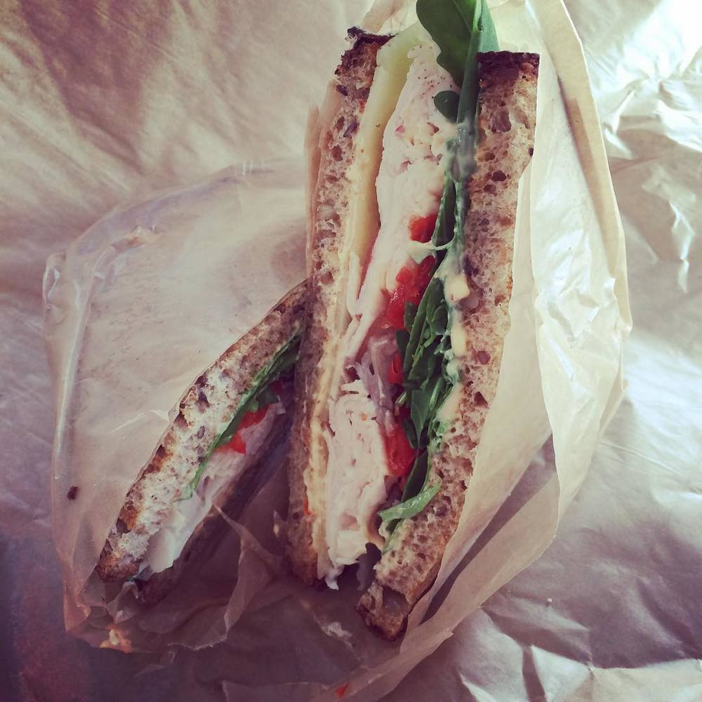What's for #lunch? Or should I say early dinner? #Turkey on #multigrain bread with #peppadew #peppers, #pickled #shallots, manchego, #arugula, and a tinge of harissa mayo from #Dépanneur in Williamsburg. Awesome combo and a nice mix of veggies, protein, whole grains, and yummy flavor. #lazynutritionist #lazynutrition #sandwichesrock