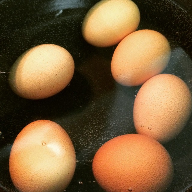 #HardBoiledEggs are a great, complete #protein that is so easy to cook! As for the #cholesterolconfusion? The #cholesterol in egg yolks does not affect your blood cholesterol as much as crappy fats do (like saturated or trans fat). The #eggyolk contains almost all the vitamins, minerals, protein, and healthy fats. DO NOT throw them away, unless you are at risk for developing #diabetes.    To Cook: Place eggs in water as the water starts to heat. Once the water starts boiling, turn off the heat, but keep the pan on the hot burner, cover, and let the eggs sit for 10-12 minutes. Add 1 tsp of vinegar to prevent cracking. Voila.    #lazynutritionist #bushwick #bushwicknutrition #eggs #completeprotein #easymeals #lazynutrition