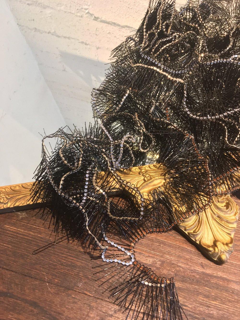Bobby pins, rhinestone necklaces, mirror