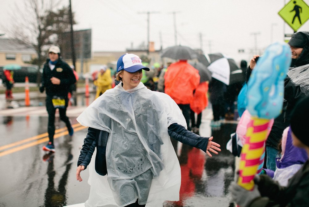 High-fives for my family at Mile 6.  I'm rocking my Boston Strong  Headsweats hat. Photo by Tina Florance