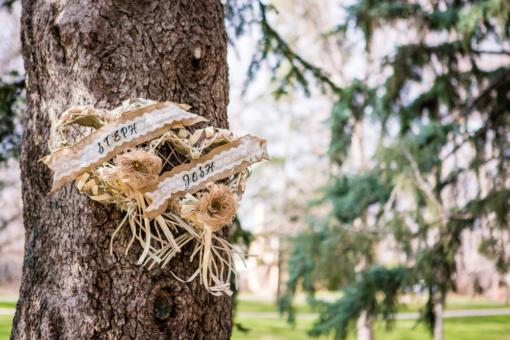 wedding details hanging from tree