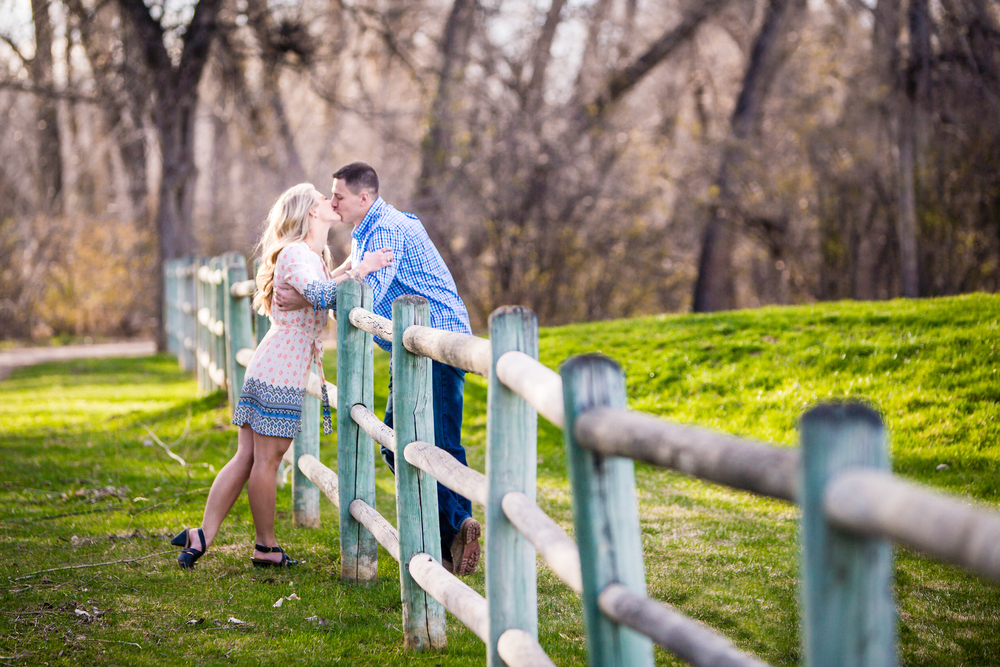 Engagement picture along wood fence. Taken in Fort Collins Colorado by Jared M. Gant