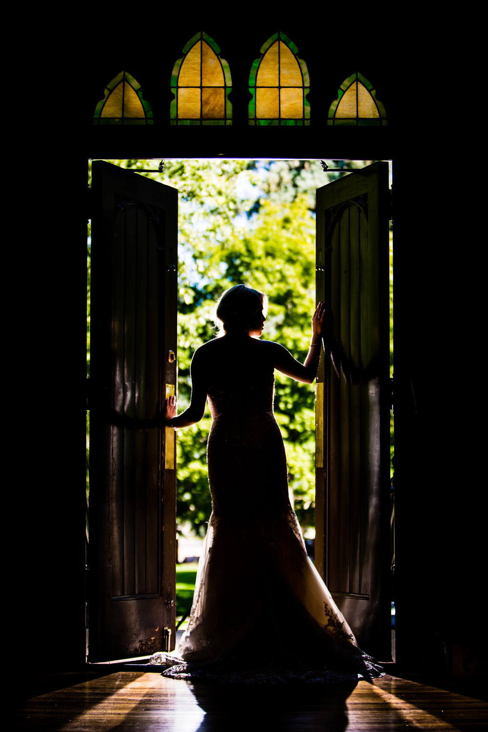 Bride in front of door. www.jmgantphotography.com