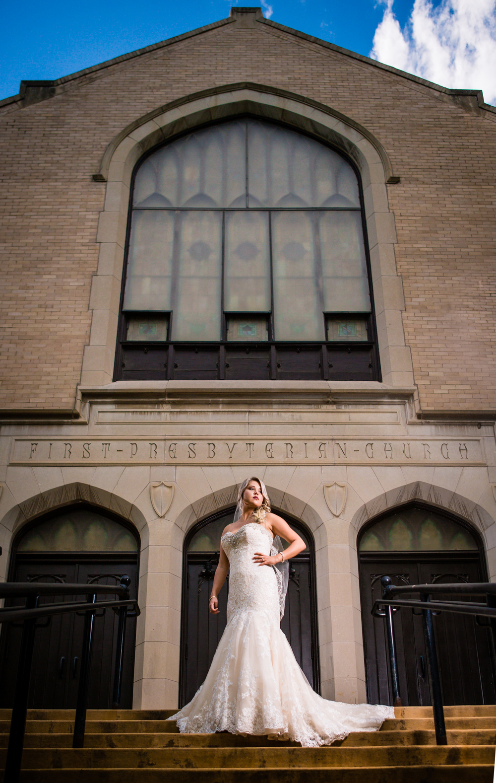 Bride standing in front of Greeley Church. www.jmgantphotography.com