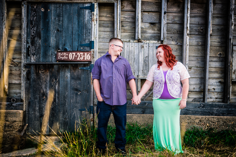 Engagements next to barn at Sandstone Ranch Park in Longmont Colorado.