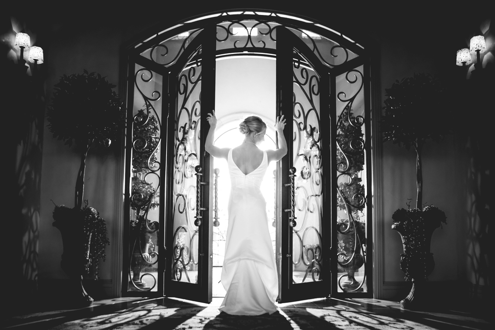 Bride in front of door. Timnath Colorado Wedding  www.JMGantPhotography.com