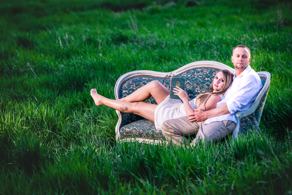 Engagement with a victorian couch at Sandstone Ranch. Take by Jared M. Gant
