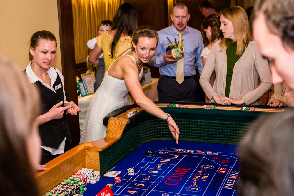 Bride enjoying one of the gaming table from Colorado Casino Nights.