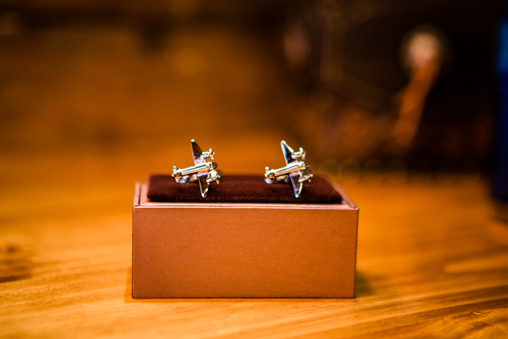 Airplane cufflinks for the groom.