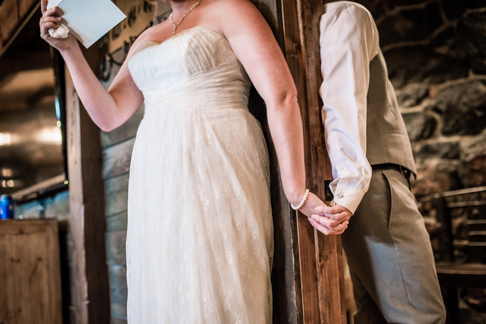 Bride and groom reading letters at their Deer Creak Valley Ranch Wedding. Photographed by JMGant Photography.
