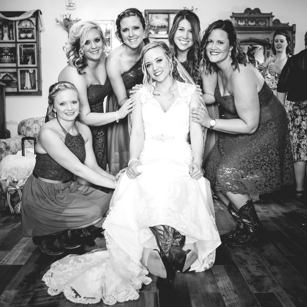 Bridesmaids helping the bride.The barn at Evergreen Memorial. Photographed by JMGant Photography.