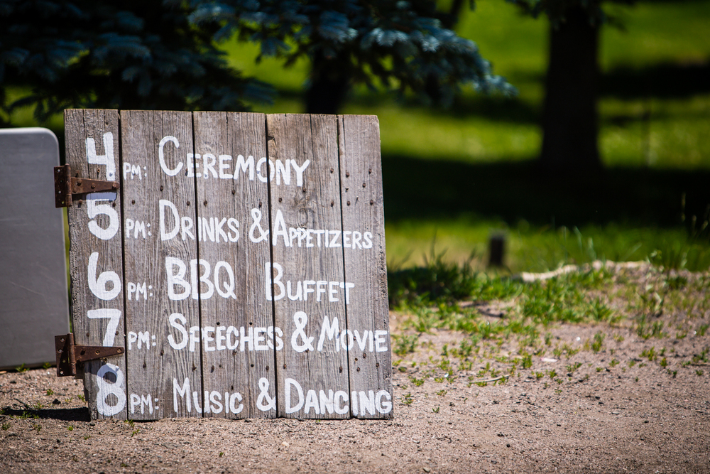 Wedding schedule sign.The barn at Evergreen Memorial. Photographed by JMGant Photography.