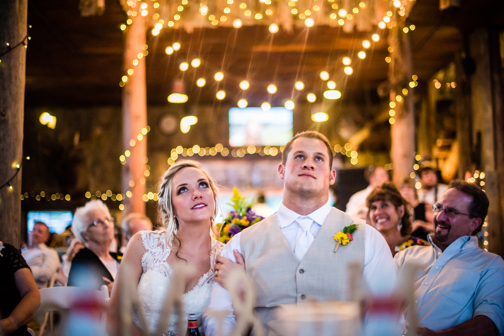 Watching their wedding video.Wedding at The barn at Evergreen Memorial. Photographed by JMGant Photography.