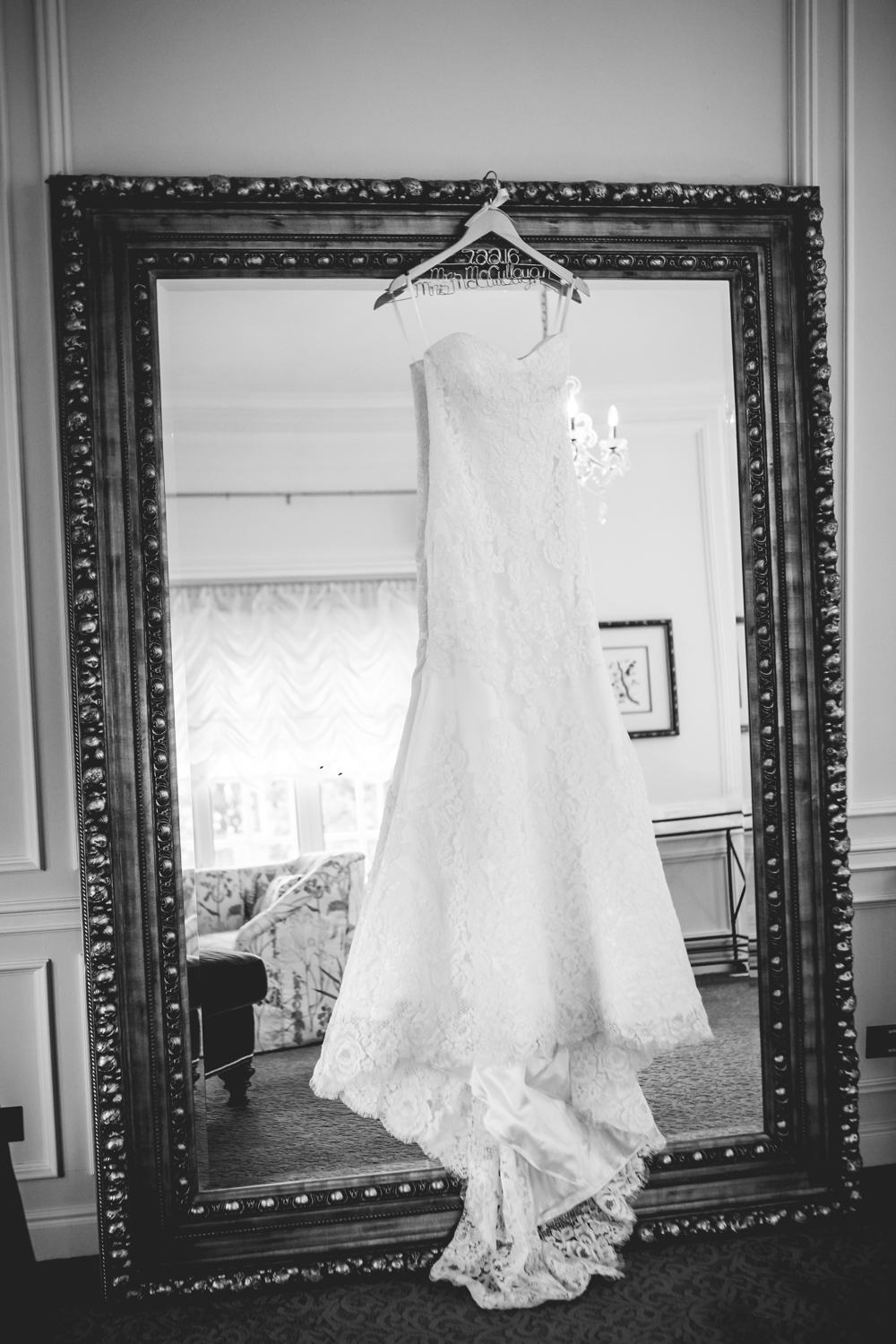 Wedding dress hanging on mirror. Photographed by JMGant Photography, Denver Colorado wedding photographer.