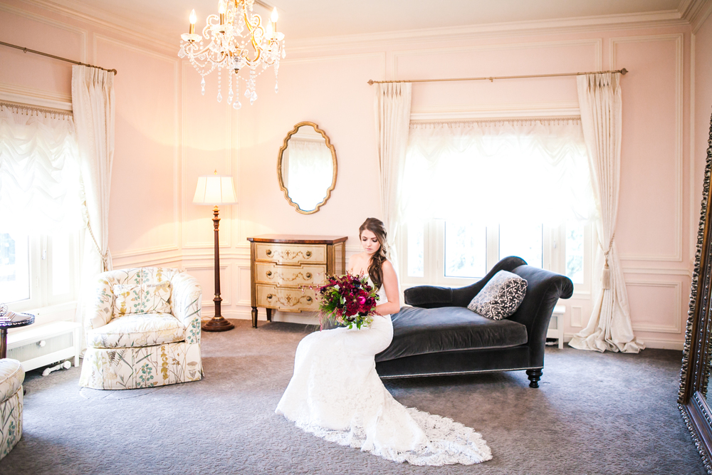 Bride in bridal suite at Highlands Ranch Mansion. Photographed by JMGant Photography, Denver Colorado wedding photographer.