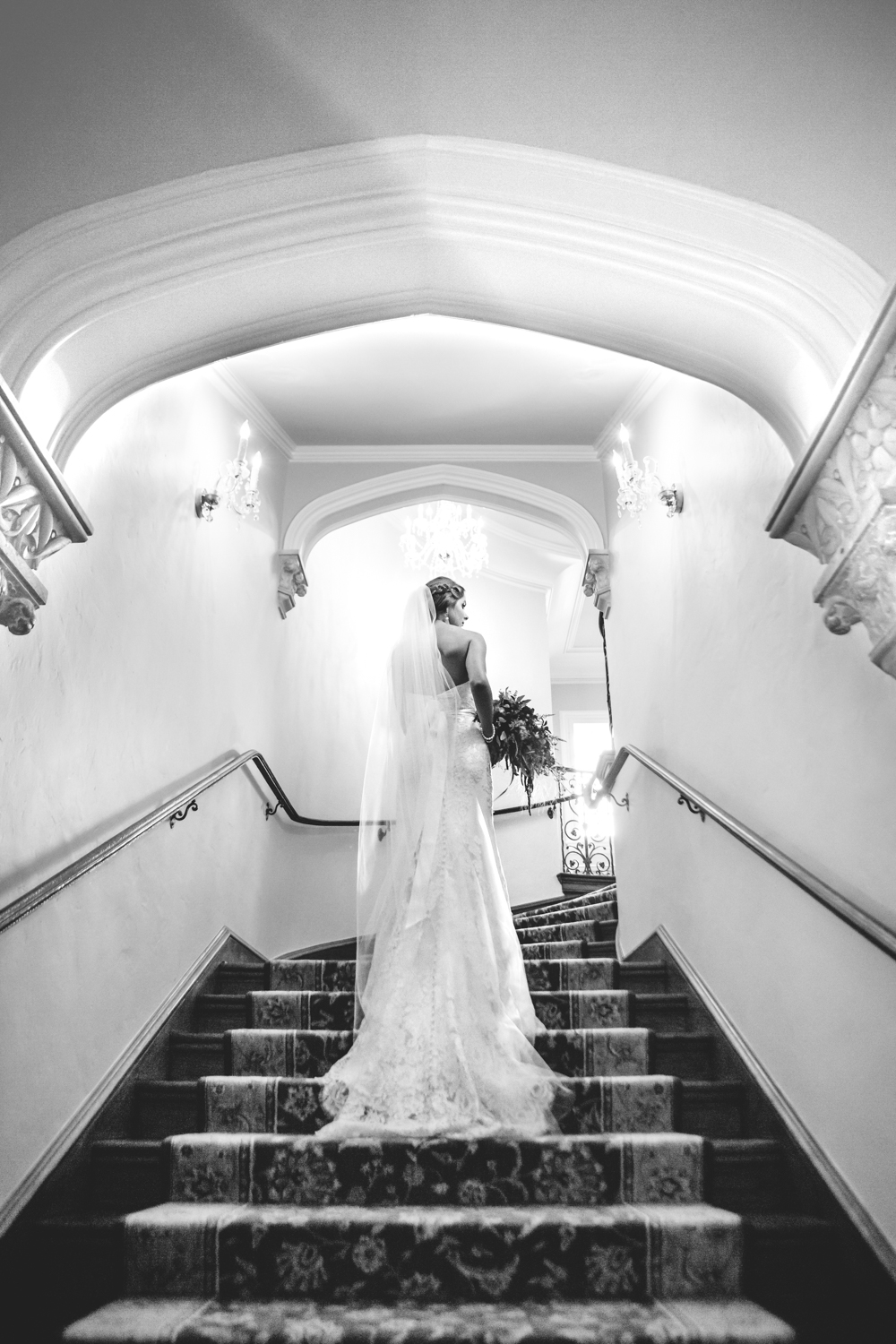 Bride walking up stairs at Highlands Ranch Mansion. Photographed by JMGant Photography.