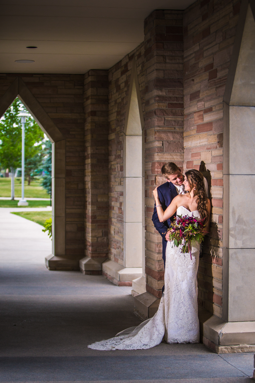 Bride and groom outside Cherry Hills Community Church.   hotographed by JMGant Photography, Denver Colorado wedding photographer.