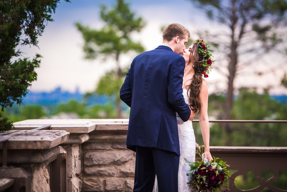 Bride and groom outside Highlands Ranch Mansion.    hotographed by JMGant Photography, Denver Colorado wedding photographer.