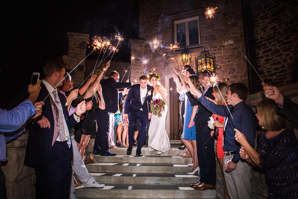 Sparkler Exit at Highlands Ranch Mansion.  Photographed by JMGant Photography, Denver Colorado wedding photographer.